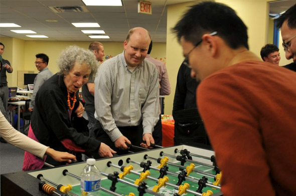 Margaret Atwood at the Wattpad office playing a game of foosball